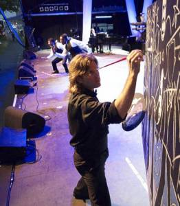 """While Three Mo' Tenors performed  while Canadian artist Eric Waugh drew the tenors """"live on stage"""".  The painting was later auctioned with proceeds going to charity."""