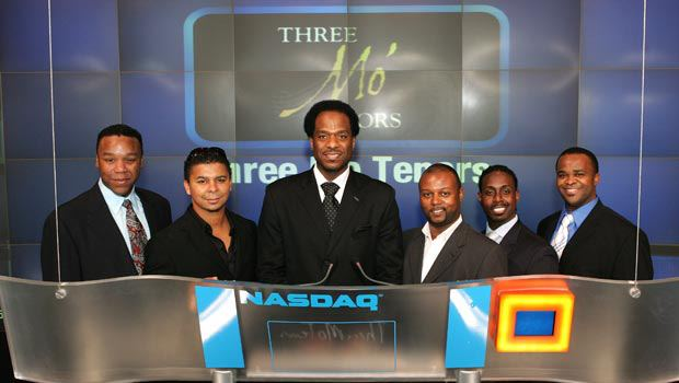Three Mo' Tenors Ramone Diggs, James N. Berger Jr., Victor Robertson, Sean T. Miller, Kenneth Alston Jr., and Phumzile Sojola ring the opening bell at The NASDAQ Stock Exchange